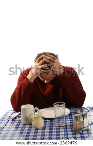 Depressed man in restaurant - stock photo