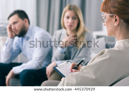 Depressed man listens as his partner talks about their private problems