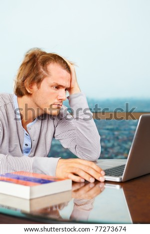 Depressed man look very stress in front of laptop