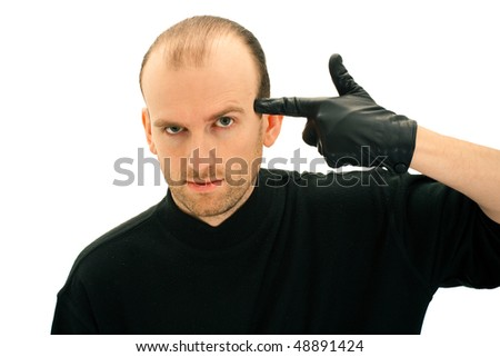 Depressed man puts finger to his temple, isolated on white background