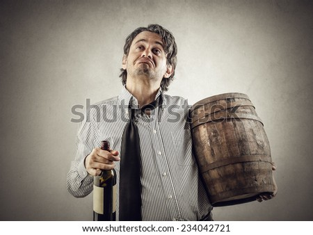 Depressed man with a bottle of wine  - stock photo