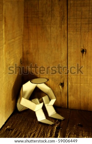 depressed paper person in corner - stock photo