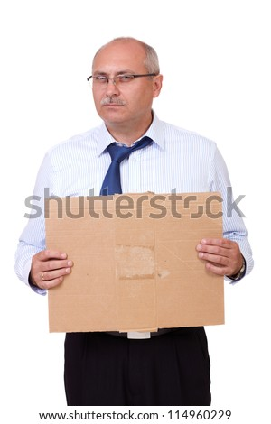 Depressed senior businessman holding a cardboard, isolated on white background