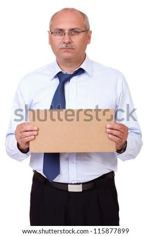 Depressed senior businessman holding a cardboard, isolated on white background - stock photo