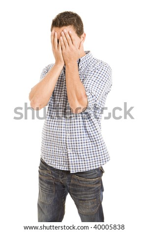 Depressed sick man covering his face with his hands