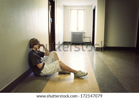 Depressed teenage boy - stock photo
