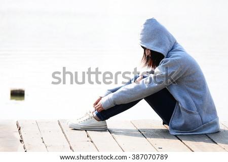 Depressed teenage girl - stock photo