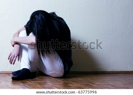 Depressed teenage girl cover the face. - stock photo