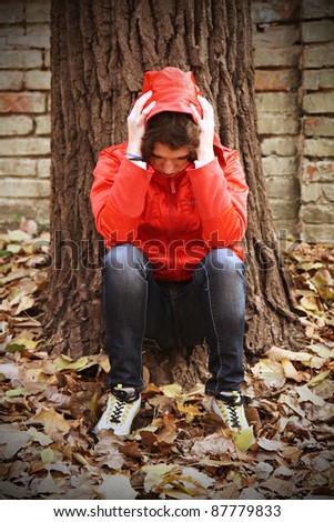 depressed teenager facing her own problems. - stock photo