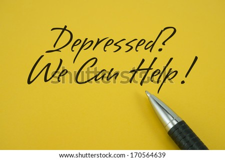 Depressed? We Can Help! note with pen on yellow background