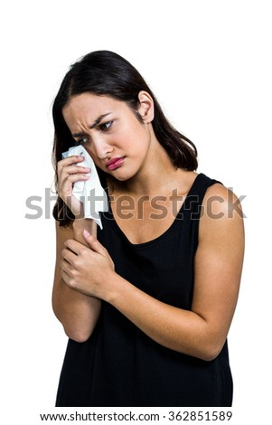 Depressed woman crying against white background - stock photo