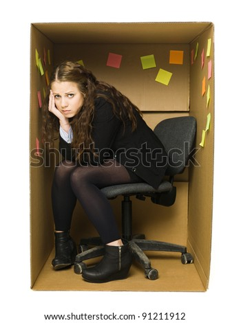 Depressed woman in a Cardboard Box office