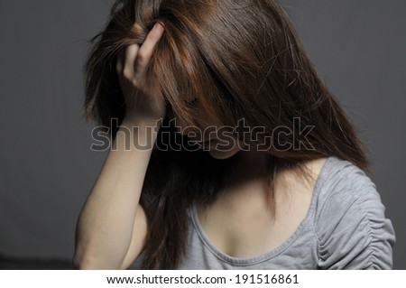 Depressed woman in despair facial close up - stock photo
