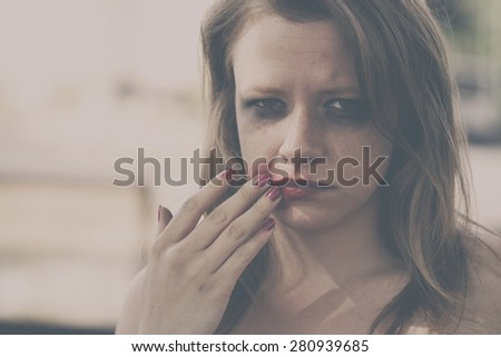 Depressed woman. Sexual violence concept - stock photo