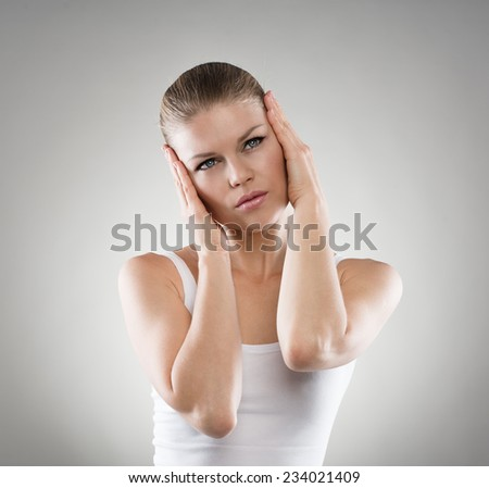 Depressed woman suffering from insomnia. Migraine or headache concept. - stock photo