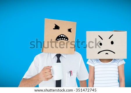 Depressed woman with box over head against blue background with vignette - stock photo