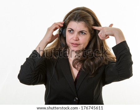 Depressed woman working a call center. Frustrated and disappointed of the job - stock photo