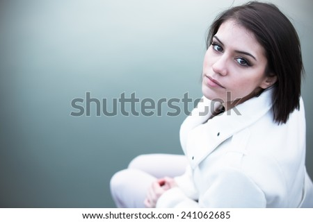 Depressed woman.Young girl depression, stress and problems, pain, female depressed.Beautiful brunette young woman with sad face. Sad expression, sad emotion,sadness. Gorgeous brunette outdoor portrait - stock photo