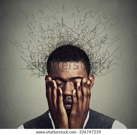Depressed worried young man with worried desperate stressed expression hands covering face and brain melting into lines question marks. Depression, anxiety disorders, life failure. Gray background  - stock photo