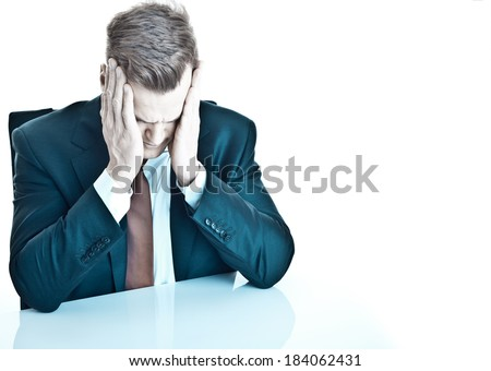 Depressed young businessman - isolated on white and much space for own text - stock photo