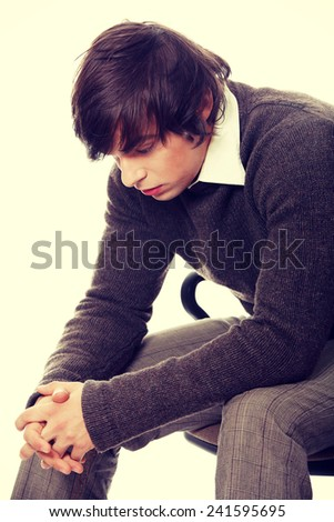 Depressed young man close up - stock photo