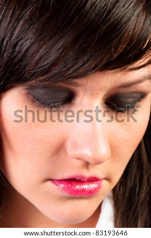 Depressed young woman closing her eyes - stock photo