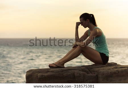 Depressed young woman deep in thoughts outdoors - stock photo