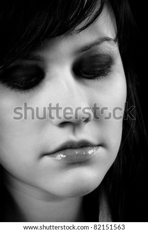 Depressed young woman in black and white - stock photo
