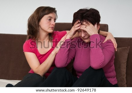 Depression - daughter regrets senior mother - stock photo