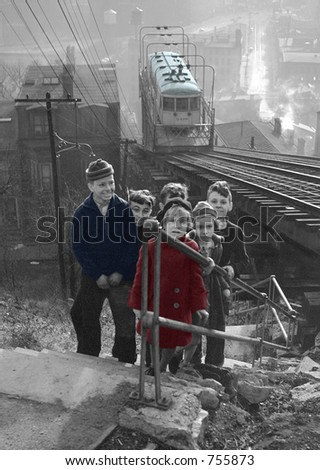 Depression era schoolchildren and electric streetcar in Cincinnati, Ohio - stock photo