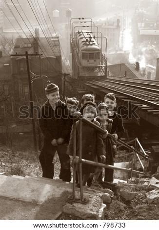 Depression era schoolchildren and electric streetcar in Cincinnati, Ohio (sepia tone) - stock photo