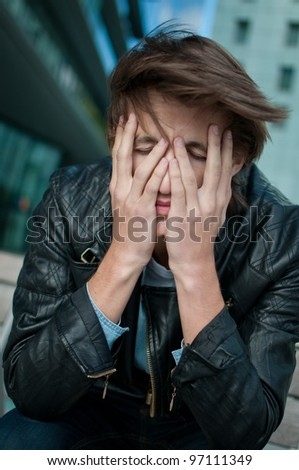 Depression - man with head in hands - stock photo