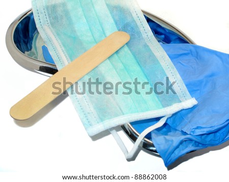 Depressor on medical face mask,gloves,plate - stock photo