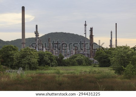 Depth of field the Oil refinery with Steam at Sunrise time.