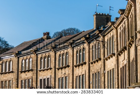 Derbyshire stone houses in the town of Buxton. - stock photo