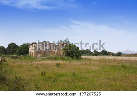 Derelict abandoned farmhouse in countryside - stock photo
