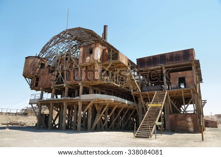 Derelict and rusting leaching plant at the historic Santa Laura Saltpeter Works in the Atacama Desert near Iquique, Chile. The site is now an open air museum and a Unesco World Heritage Site. - stock photo