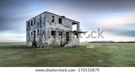 Derelict control tower at an abandoned WWII airfield at Davidstow in Cornwall - stock photo