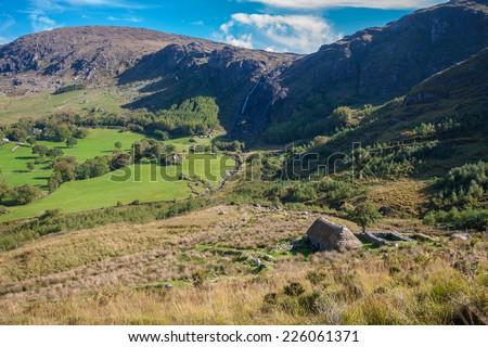 Derelict Cottage Set In Beautiful Irish Valley - stock photo