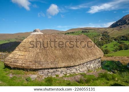 Derelict Famine Cottage Set In Beautiful Irish Valley - stock photo