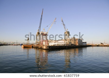 Derelict industrial waterfront in warm afternoon light. - stock photo