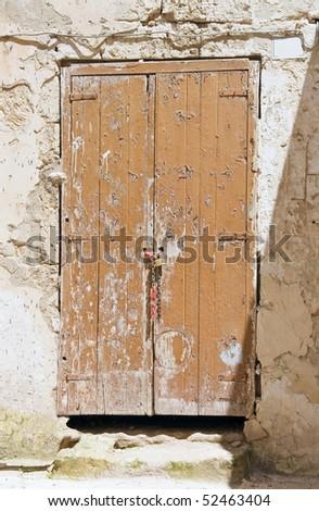 Derelict wooden door. - stock photo