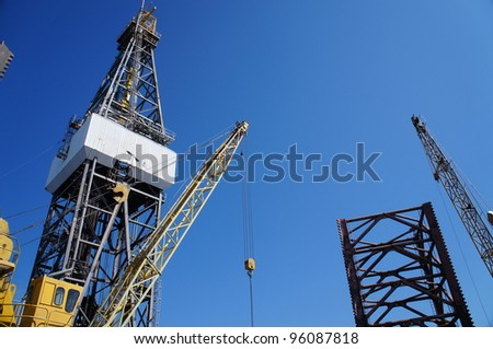 Derick of jack up drilling rig with the rig crane on Sunny Blue Sky Day - stock photo