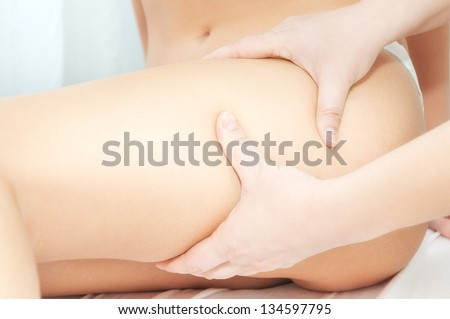 Dermatologist inspecting woman patients skin