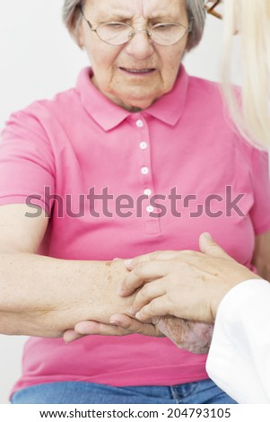 Dermatologist looking at patient skin. - stock photo