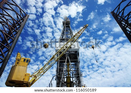 Derrick of Offshore Jack Up Oil Drilling Rig and Rig Crane - stock photo