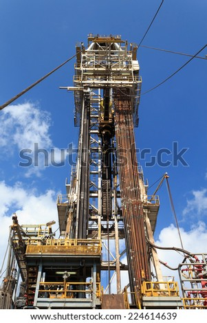 Derrick of Tender Drilling Oil Rig (Barge Oil Rig) on The Production Platform - stock photo