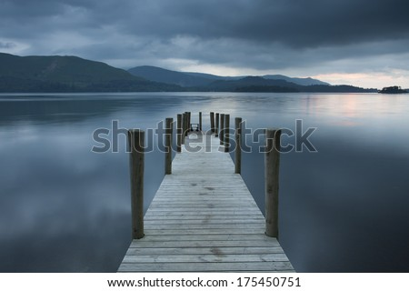 derwent jetty on a moody cloudy day at sunset, cumbria - stock photo