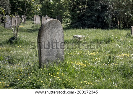 Desaturated Grave and grass field - stock photo