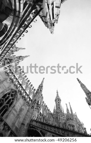 desaturated photo of duomo cathedral on milan, italy - stock photo